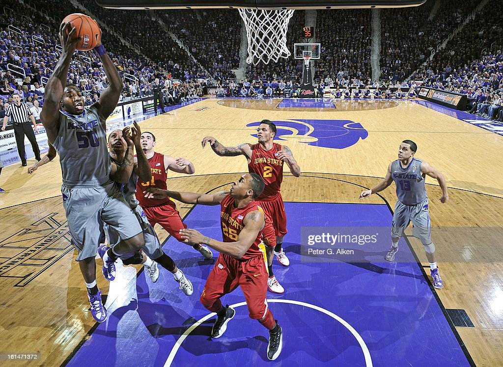 Forward D.J. Johnson #50 of the Kansas State Wildcats pulls down a rebound over guard Tyrus McGee #25 of the Iowa State Cyclones during the second half on February 9, 2013 at Bramlage Coliseum in Manhattan, Kansas.