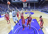 Forward DJ Johnson of the Kansas State Wildcats shoots the ball against forward Ryan Spangler of the Oklahoma Sooners during the first half on...