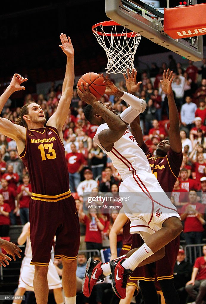 Forward D.J. Shelton #23 of the Washington State Cougars drives to the hoop while center Jordan Bachynski #13 of the Arizona State Sun Devils defends during the first half of the game at Beasley Coliseum on January 31, 2013 in Pullman, Washington.