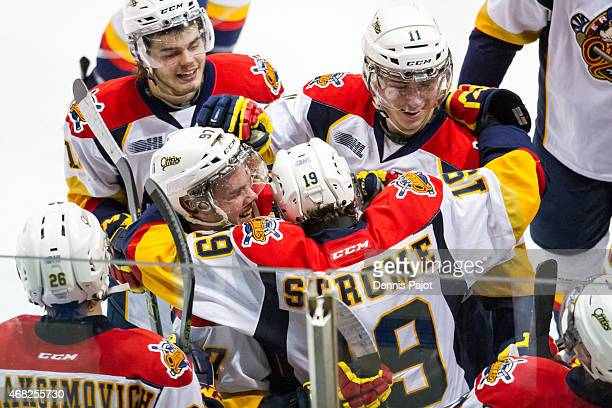 Forward Dylan Strome of the Erie Otters celebrates his game winning overtime goal against the Sarnia Sting to win 43 during Game Four of the Western...