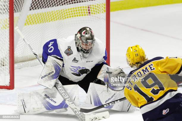 Forward Dylan Strome of the Erie Otters fires the puck against goaltender Callum Booth of the Saint John Sea Dogs on May 26 2017 during the semifinal...