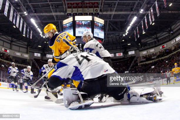 Forward Dylan Strome of the Erie Otters moves the puck against goaltender Callum Booth of the Saint John Sea Dogs on May 26 2017 during the semifinal...