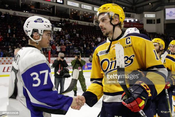 Forward Dylan Strome of the Erie Otters shakes hands with forward Cole Reginato of the Saint John Sea Dogs after a 63 Erie win on May 26 2017 during...