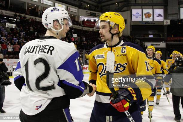 Forward Dylan Strome of the Erie Otters shakes hands with forward Julien Gauthier of the Saint John Sea Dogs after a 63 Erie win on May 26 2017...