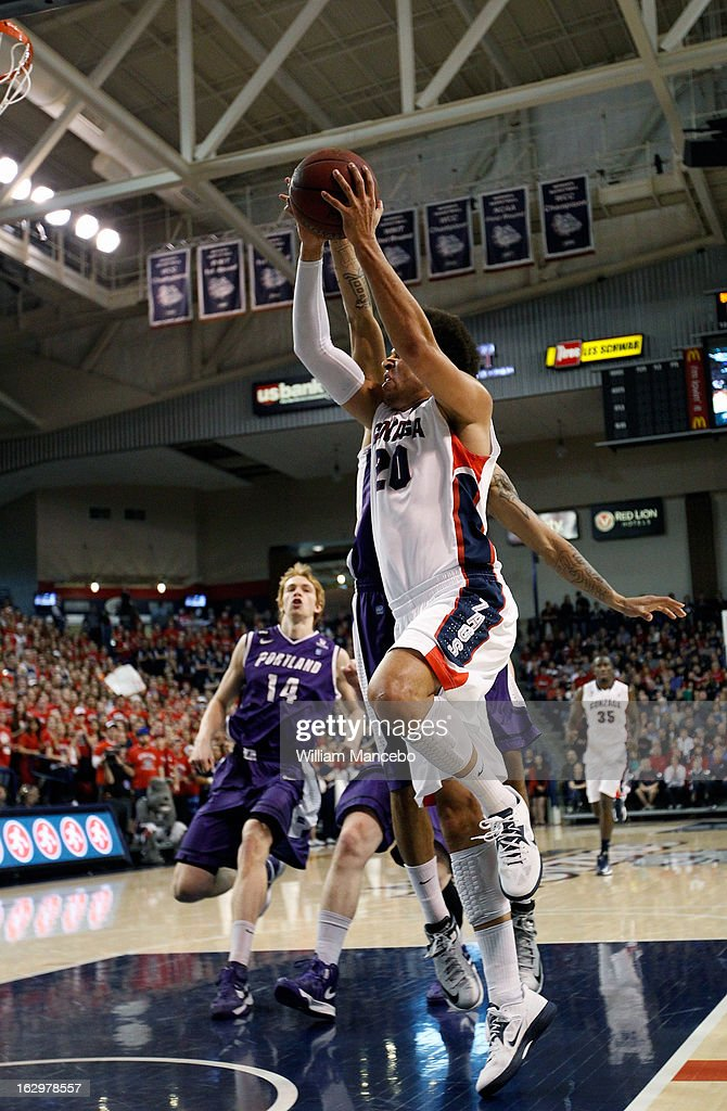 Forward Elias Harris #20 of the Gonzaga Bulldogs drives to the hoop while center Riley Barker #14 of the Portland Pilots looks on during the first half of the game against the Portland Pilots at McCarthey Athletic Center on March 2, 2013 in Spokane, Washington.