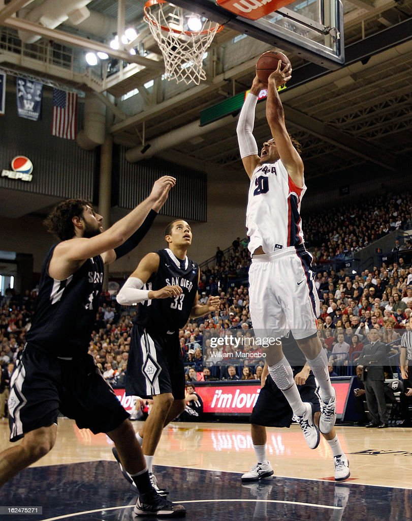 Forward Elias Harris #20 of the Gonzaga Bulldogs goes to the hoop while John Sinis #31 and Jito Kok #33 of the San Diego Toreros defend during the game at McCarthey Athletic Center on February 23, 2013 in Spokane, Washington.