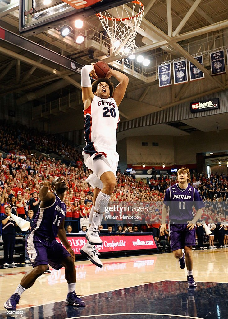 Forward <a gi-track='captionPersonalityLinkClicked' href=/galleries/search?phrase=Elias+Harris&family=editorial&specificpeople=6164446 ng-click='$event.stopPropagation()'>Elias Harris</a> #20 of the Gonzaga Bulldogs goes up for a dunk while guard Derrick Rodgers #15 and forward Jake Ehlers #11 of the Portland Pilots defend during the game at McCarthey Athletic Center on March 2, 2013 in Spokane, Washington.
