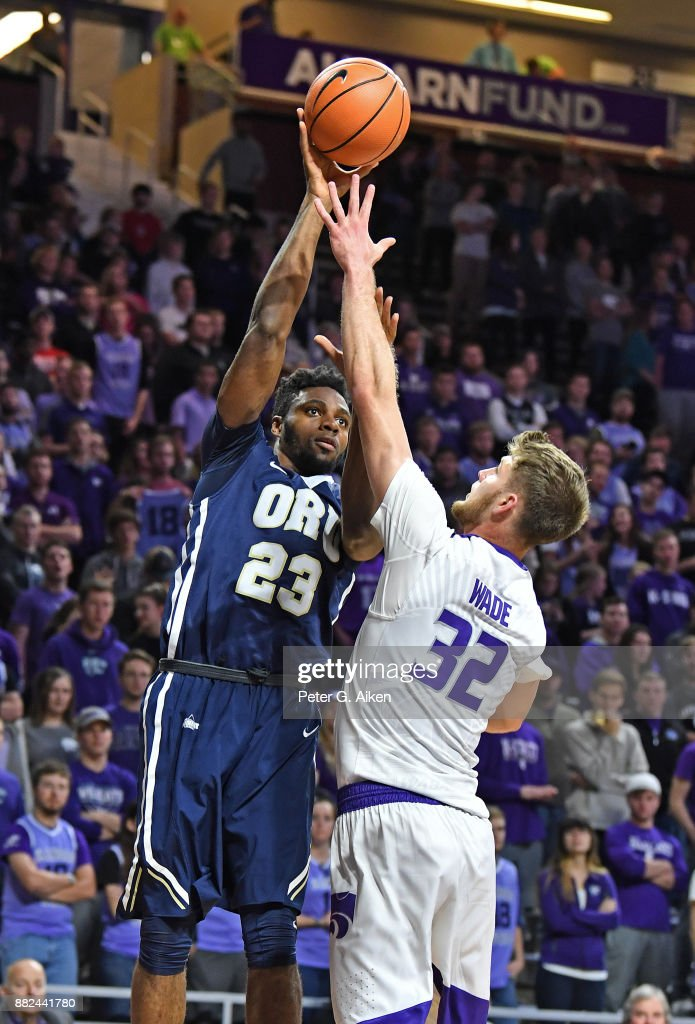 Forward Emmanuel Nzekwesi #23 of the Oral Roberts Golden Eagles puts up a shot against forward Dean Wade #32 of the Kansas State Wildcats during the first half on November 29, 2017 at Bramlage Coliseum in Manhattan, Kansas.