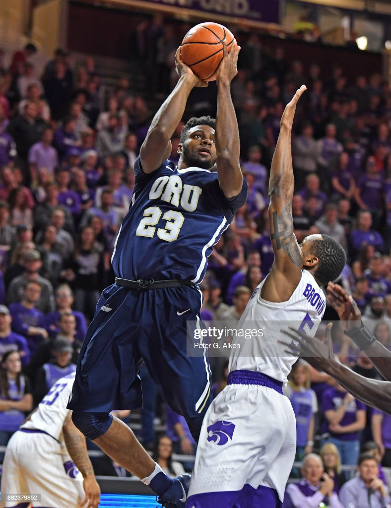 Forward Emmanuel Nzekwesi #23 of the Oral Roberts Golden Eagles shoots the ball against guard Barry Brown #5 of the Kansas State Wildcats during the first half on November 29, 2017 at Bramlage Coliseum in Manhattan, Kansas.