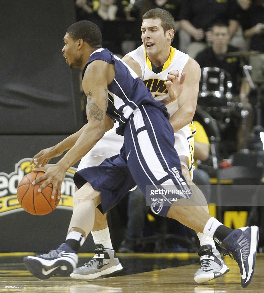 Forward Eric May #25 of the Iowa Hawkeyes defends during the second half against guard Jermaine Marshall #11 of the Penn State Nittany Lions on January 31, 2013 at Carver-Hawkeye Arena in Iowa City, Iowa. Iowa won 76-67.