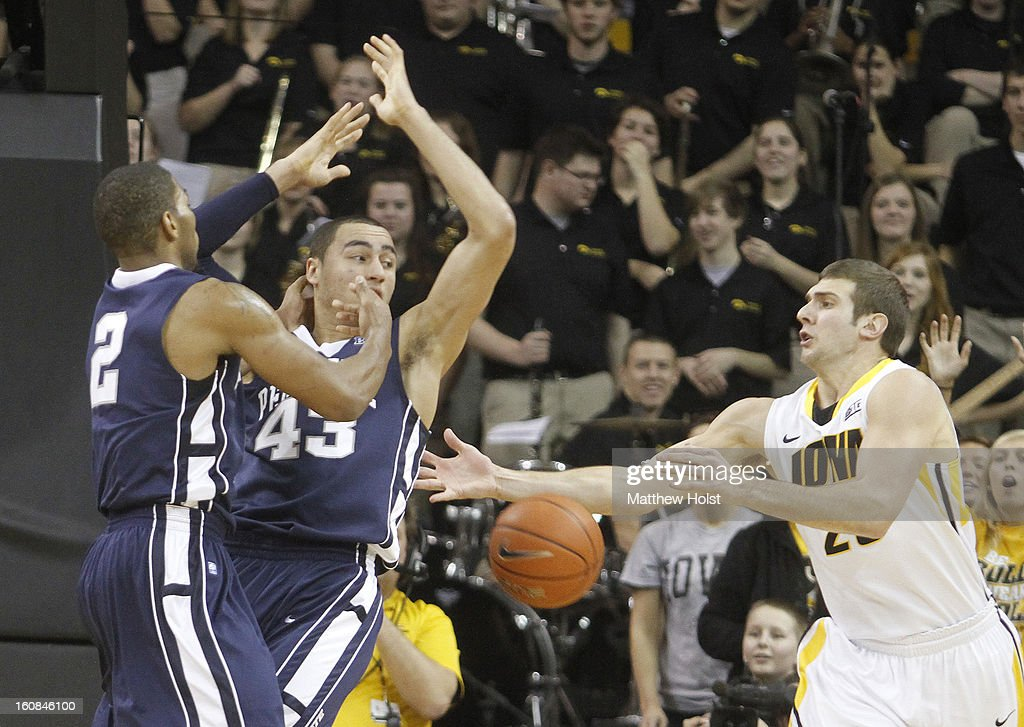 Forward Eric May #25 of the Iowa Hawkeyes grabs a rebound during the first half in front of guard D.J. Newbill #2 and forward Travis Ross #43 of the Penn State Nittany Lions on January 31, 2013 at Carver-Hawkeye Arena in Iowa City, Iowa. Iowa won 76-67.