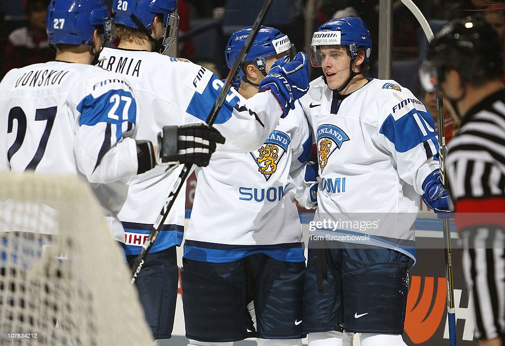 Forward Erik Haula #10 of Finland celebrates his goal with teammates during the 2011 IIHF World U20 Championship game between Slovakia and Finland on December 31, 2010 at HSBC Arena in Buffalo, New York.