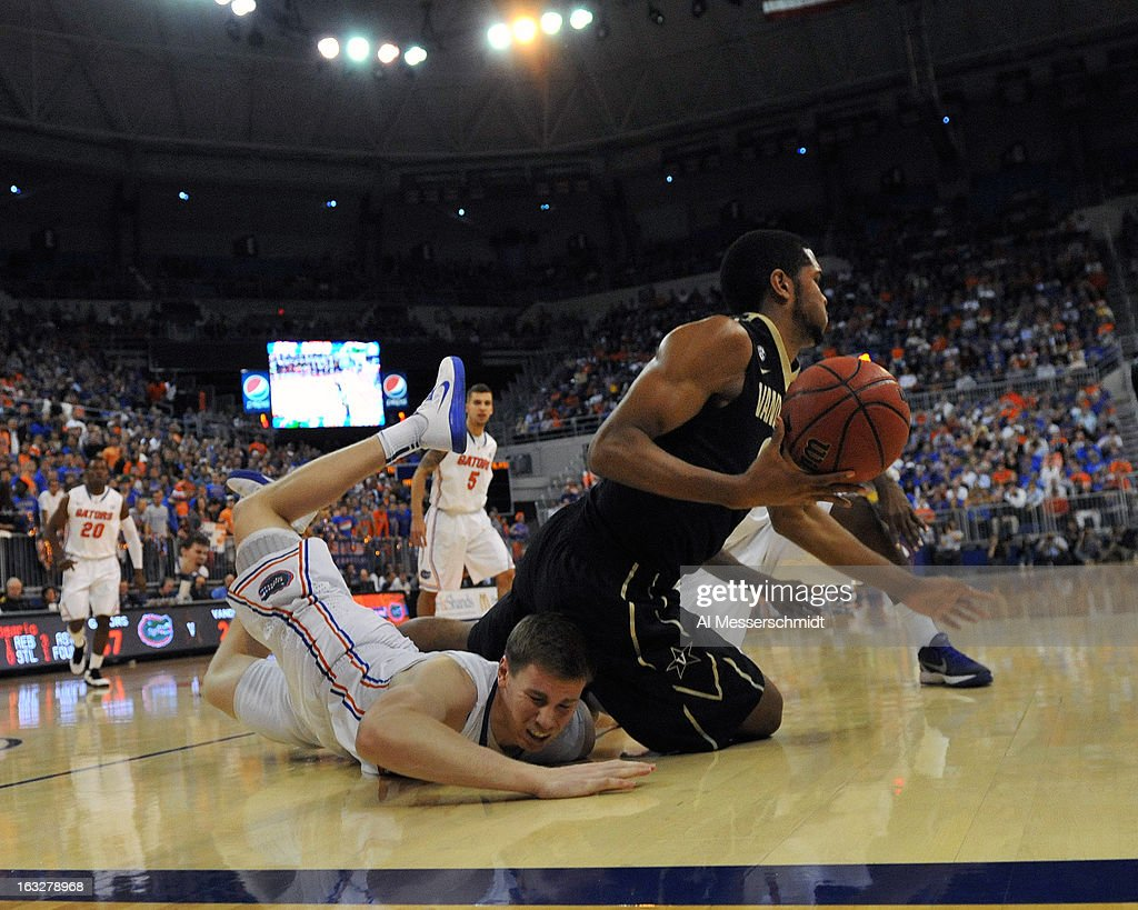 Forward Erik Murphy #33 of the Florida Gators dives as forward Sheldon Jeter #21 of the Vanderbilt Commodores grabs a loose ball March 6, 2013 at Stephen C. O'Connell Center in Gainesville, Florida.