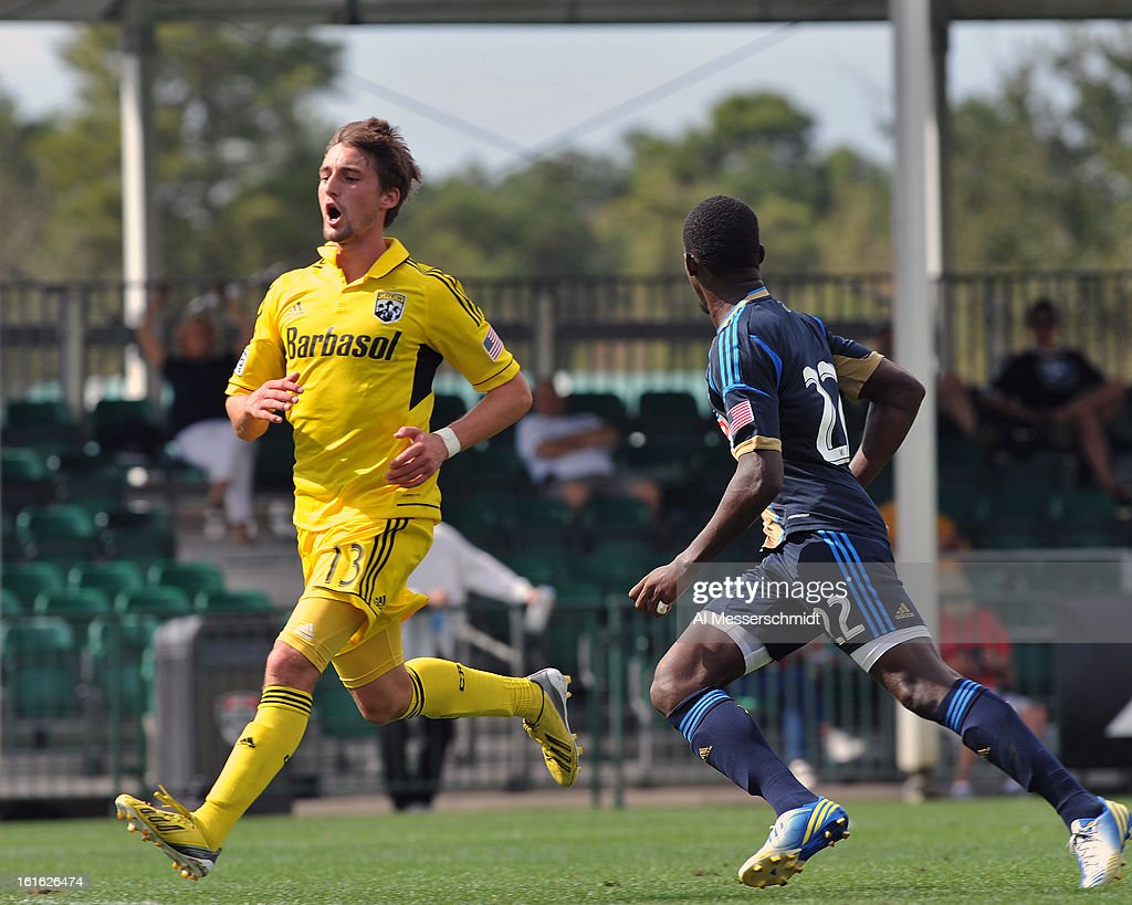 Forward Ethan Finlay #13 of the Columbus Crew runs upfieldagainst the Philadelphia Union February 13, 2013 in the second round of the Disney Pro Soccer Classic in Orlando, Florida. Finlay scored twice.
