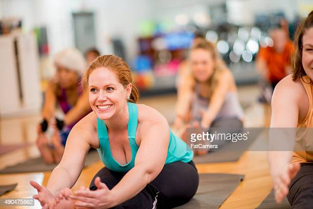 Forward Fold in Yoga Fitness Class