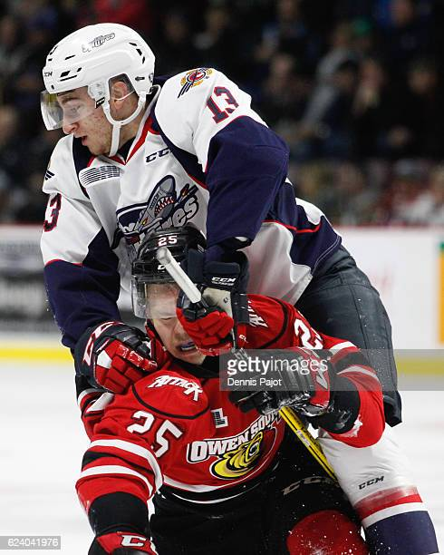 Forward Gabriel Vilardi of the Windsor Spitfires battles against forward Petrus Palmu of the Owen Sound Attack on November 17 2016 at the WFCU Centre...
