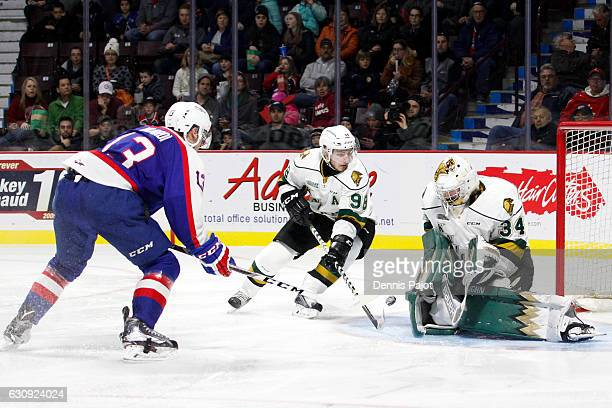 Forward Gabriel Vilardi of the Windsor Spitfires shoots the puck against goaltender Tyler Johnson of the London Knights on January 3 2017 at the WFCU...
