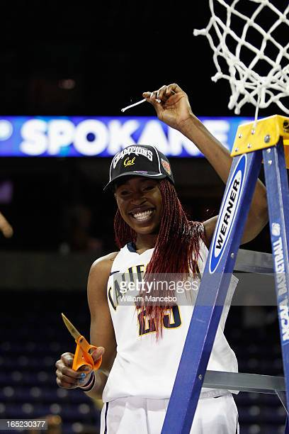 Forward Gennifer Brandon of the California Golden Bears celebrates by cutting off the net after the game against the Georgia Lady Bulldogs during the...