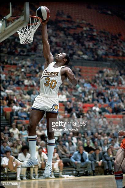 Forward George McGinnis of the American Basketball Association Indiana Pacers in action at Market Square Arena on February 8 1975 in Indianapolis...
