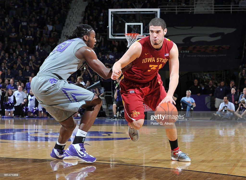 Forward Georges Niang #31 of the Iowa State Cyclones drives around forward D.J. Johnson #50 of the Kansas State Wildcats during the first half on February 9, 2013 at Bramlage Coliseum in Manhattan, Kansas.
