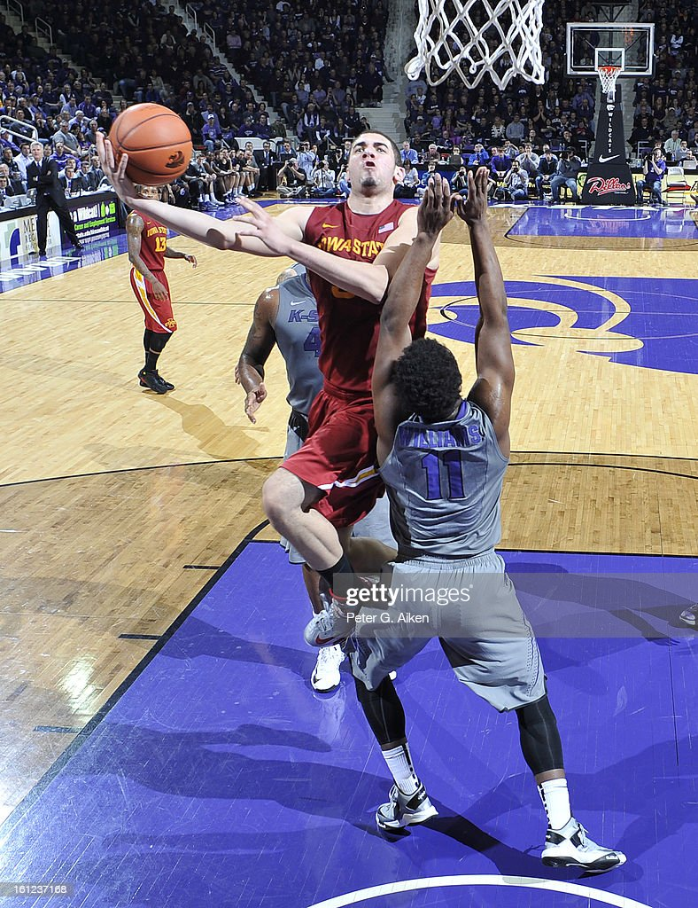 Forward Georges Niang #31 of the Iowa State Cyclones drives to the basket against guard Nino Williams #11 of the Kansas State Wildcats during the second half on February 9, 2013 at Bramlage Coliseum in Manhattan, Kansas. Kansas State defeated Iowa State 79-70.