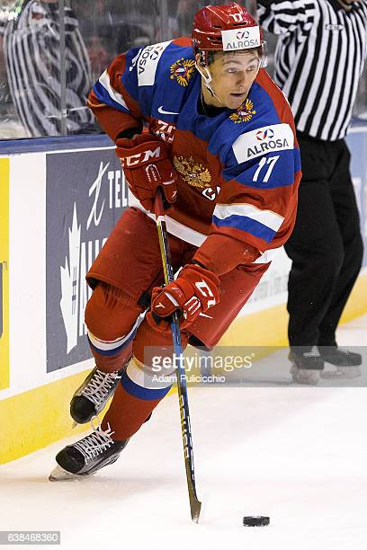 Forward German Rubtsov of Team Russia skates with the puck along the boards against Team Slovakia in a preliminary round Group B game during the IIHF...
