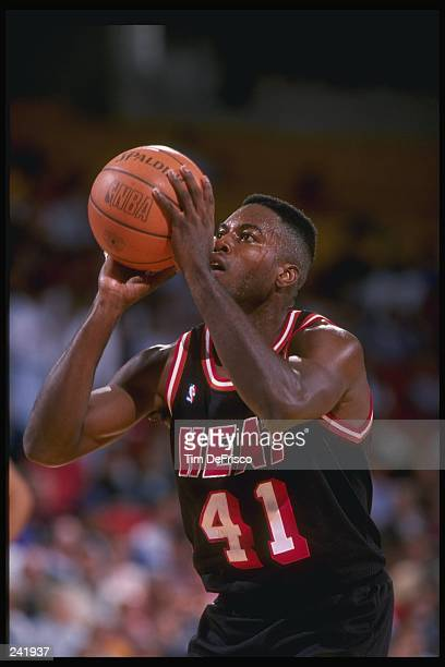 Forward Glen Rice of the Miami Heat prepares to shoot the ball during a game against the Denver Nuggets at the McNichols Arena in Denver Colorado