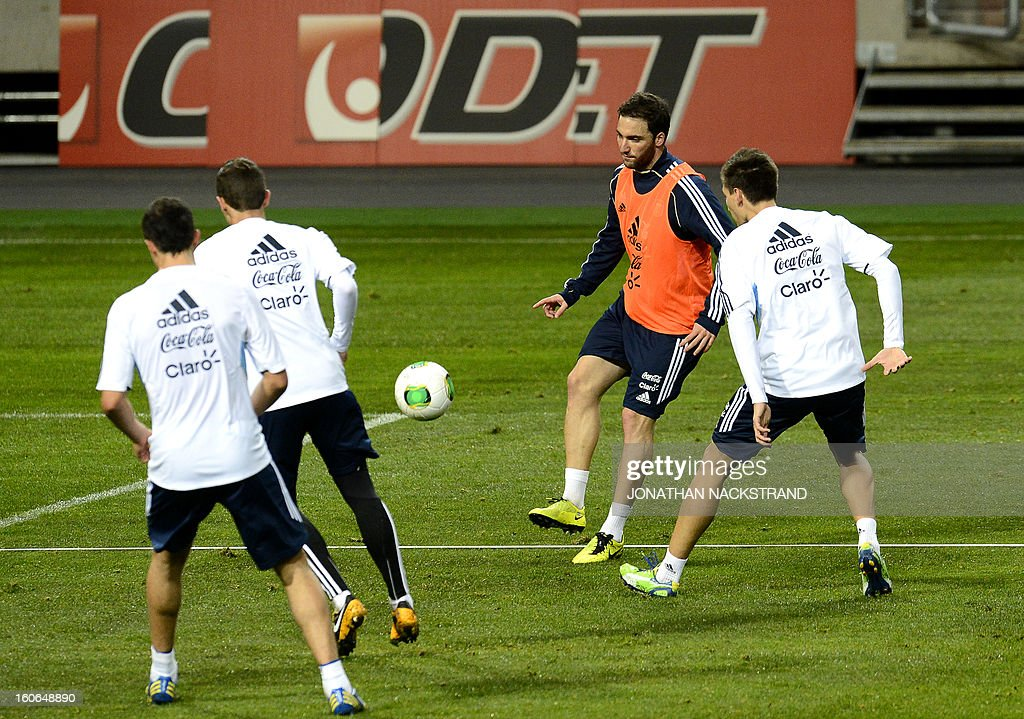 Forward Gonzalo Higuain (2ndR) takes part in a training session of the Argentina national football team at the 'Friends Arena' in Stockholm, Sweden, on February 4, 2013 two days before the FIFA World Cup 2014 friendly match Sweden vs Argentina.