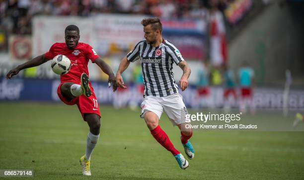 Forward Haris Seferovic of Eintracht Frankfurt and Defense Dayot Upamecano of RB Leipzig fighting for the ball at the Commerzbank Arena during the 1...