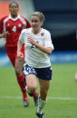 Forward Heather O'Reilly of the USA runs against Canada during the international women's soccer friendly at RFK Stadium on April 26 2003 in...