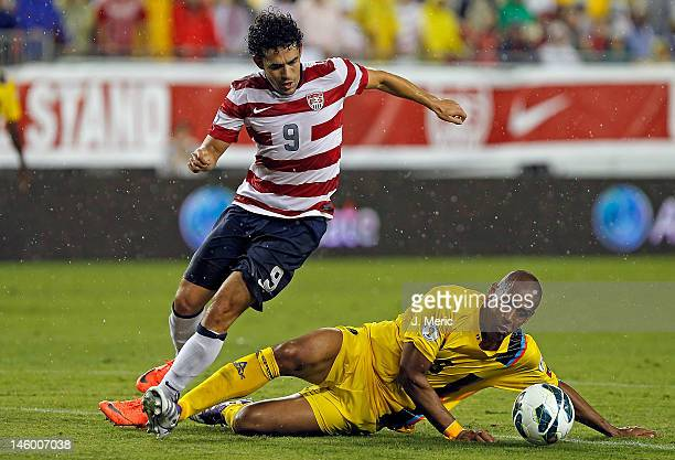 Forward Herculez Gomez of Team USA battles defender Marc Joseph of Team Antigua and Barbuda for the ball during the FIFA World Cup Qualifier Match at...