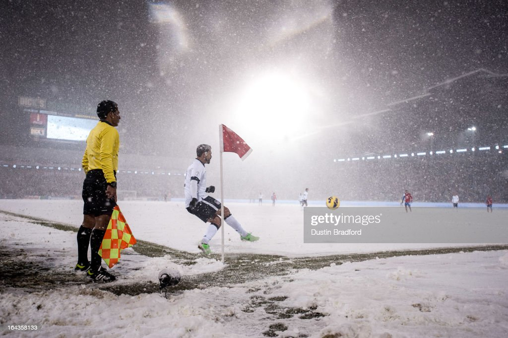 Forward Herculez Gomez #9 of the United States sends a corner kick toward the goal as snow falls during a FIFA 2014 World Cup Qualifier match between Costa Rica and United States at Dick's Sporting Goods Park on March 22, 2013 in Commerce City, Colorado.