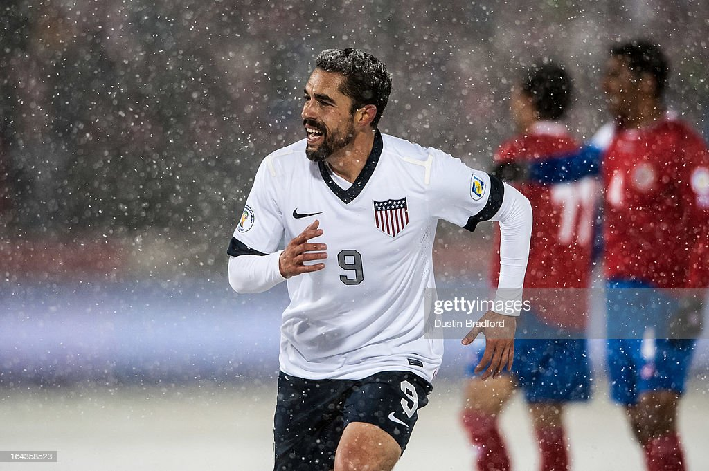 Forward Herculez Gomez #9 of the United States smiles after his teammate scored the loan goal in the game during a FIFA 2014 World Cup Qualifier match between Costa Rica and United States at Dick's Sporting Goods Park on March 22, 2013 in Commerce City, Colorado.