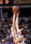 Forward Hidayet Turkoglu of the Sacramento Kings goes for the tip over Stanislav Medvedenko of the Los Angeles Lakers in Game Seven of the NBA...