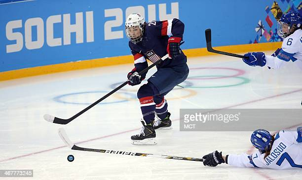 US forward Hilary Knight skates against Finland's Mira Jalosuo during the first period in a women's hockey game at the Winter Olympics in Sochi...