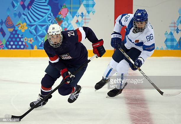 US forward Hilary Knight skates ahead of Finland's Emma Nuutinen during the second period in a women's hockey game at the Winter Olympics in Sochi...