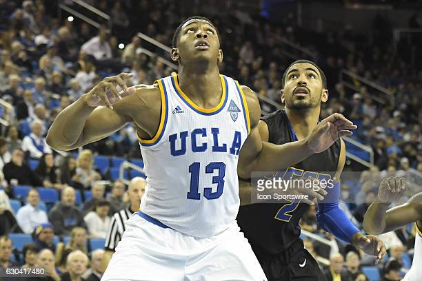 UCLA forward Ike Anigbogu boxes out UCSB guard Clifton Powell during an NCAA basketball game between the UC Santa Barbara Gauchos and the UCLA Bruins...