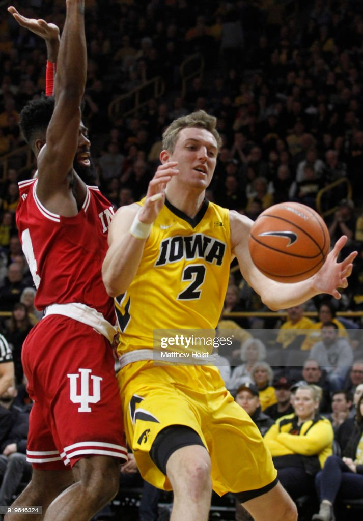 Forward Jack Nunge #2 of the Iowa Hawkeyes loses the ball during the first half driving against guard Robert Johnson #4 of the Indiana Hoosiers on February 17, 2018 at Carver-Hawkeye Arena, in Iowa City, Iowa.