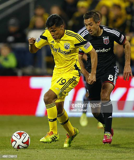 Forward Jairo Arrieta of the Columbus Crew dribbles the ball by midfielder Davy Arnaud of DC United during the first half of their game at Columbus...