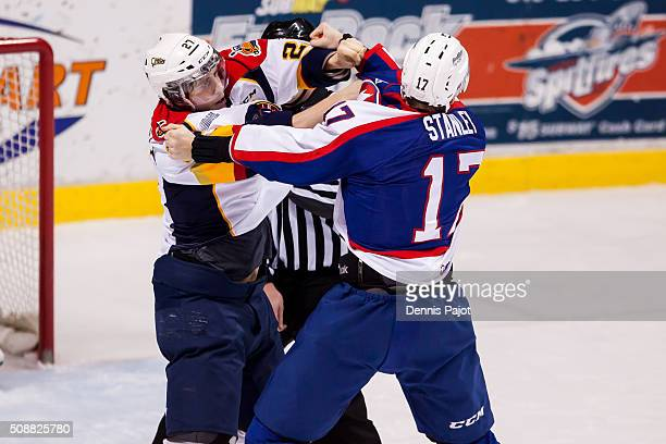 Forward Jake Marchment of the Erie Otters throws a punch during a fight against defeceman Logan Stanley of the Windsor Spitfires on February 6 2016...