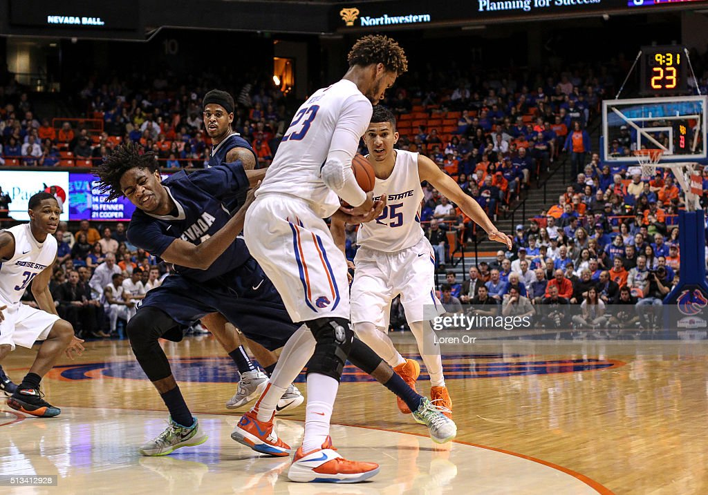 Forward James Webb III of the Boise State Broncos strips the ball from guard Lindsey Drew of the Nevada Wolf Pack during second half action on March...