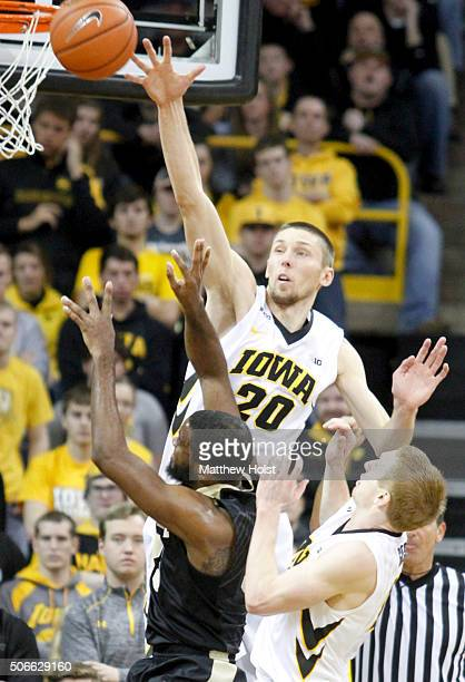 Forward Jarrod Uthoff and guard Mike Gesell of the Iowa Hawkeyes defend against guard Raphael Davis of the Purdue Boilermakers in the second half on...