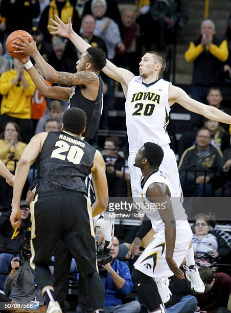Forward Jarrod Uthoff of the Iowa Hawkeyes defends against forward Vince Edwards of the Purdue Boilermakers in the first half on January 24 2016 at...