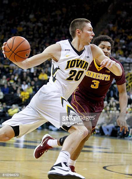 Forward Jarrod Uthoff of the Iowa Hawkeyes drives to the basket against forward Jordan Murphy of the Minnesota Golden Gophers in the first half on...