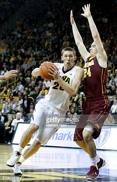 Forward Jarrod Uthoff of the Iowa Hawkeyes goes to the basket against forward Joey King of the Minnesota Golden Gophers in the first half on February...