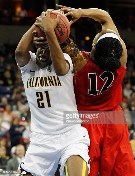 Forward Jasmine Hassell of the Georgia Lady Bulldogs battles for possession of the ball against forward Reshanda Gray of the California Golden Bears...