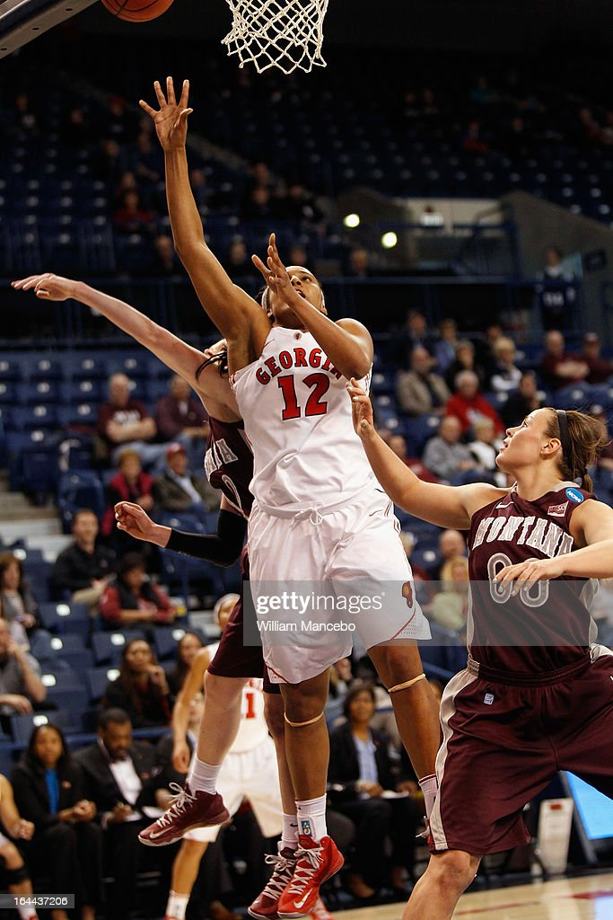 Forward Jasmine Hassell #12 of the Georgia Lady Bulldogs makes a goal attempt during the second half of the game against the Montana Grizzlies at McCarthey Athletic Center on March 23, 2013 in Spokane, Washington. The Lady Bulldogs defeated the Grizzlies 70-50.
