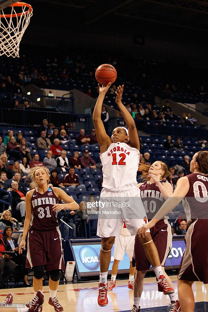Forward Jasmine Hassell #12 of the Georgia Lady Bulldogs shoots for a goal during the second half of the game against the Montana Grizzlies at McCarthey Athletic Center on March 23, 2013 in Spokane, Washington. The Lady Bulldogs defeated the Grizzlies 70-50.