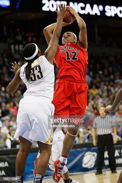 Forward Jasmine Hassell of the Georgia Lady Bulldogs shoots over center Talia Caldwell of the California Golden Bears in the first half during the...