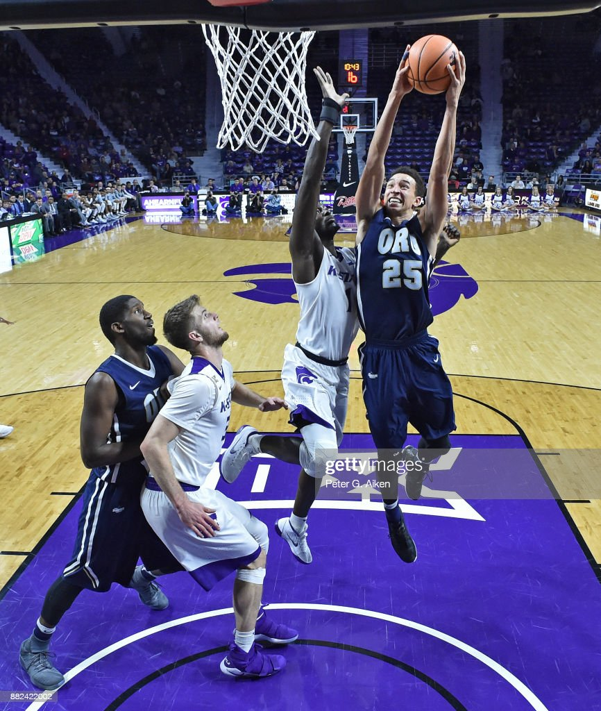 Forward Javan White #25 of the Oral Roberts Golden Eagles drives to the basket against forward Mawdo Sallah #1 of the Kansas State Wildcats during the second half on November 29, 2017 at Bramlage Coliseum in Manhattan, Kansas.